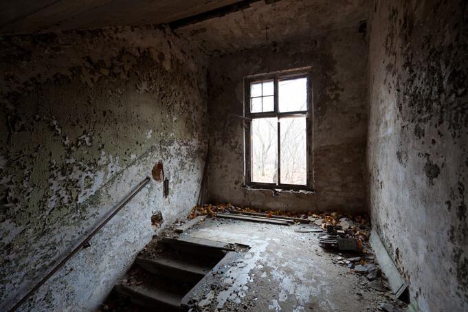 An eerie stairway in one of Berlin's abandoned spaces: the Beelitz-Heilstätten. Source.