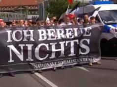 Die Gedenkdemo für Rudolf Heß musste wegen Blockaden umgeleitet werden. (Screenshot: YouTube)